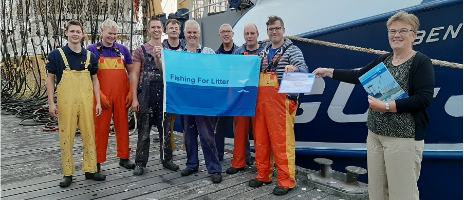 Tea Both, Alderman of Goeree Overflakkee and Vice-Chair of KIMO Netherlands and Belgium presents a Fishing for Litter certificate to a crew of Dutch fishermen.