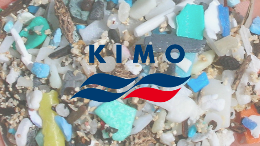 Small pieces of plastic known as micoplastics washed up on a beach, with KIMO logo.