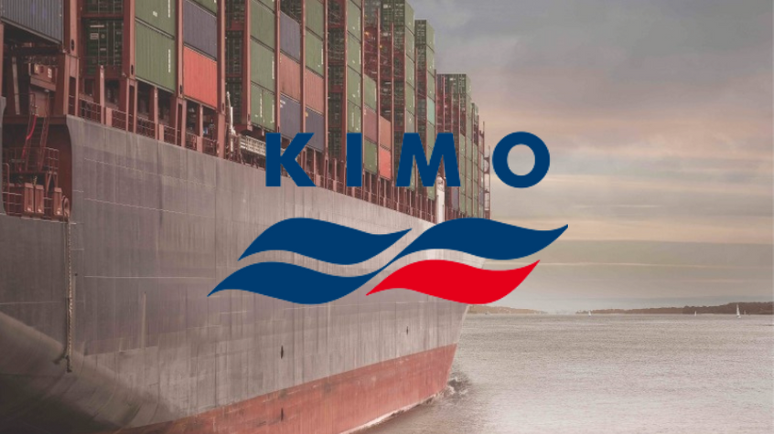 A container ship leaving harbour, with KIMO logo.