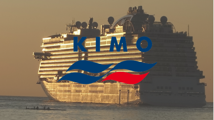 A cruise ship leaving port, with KIMO logo,