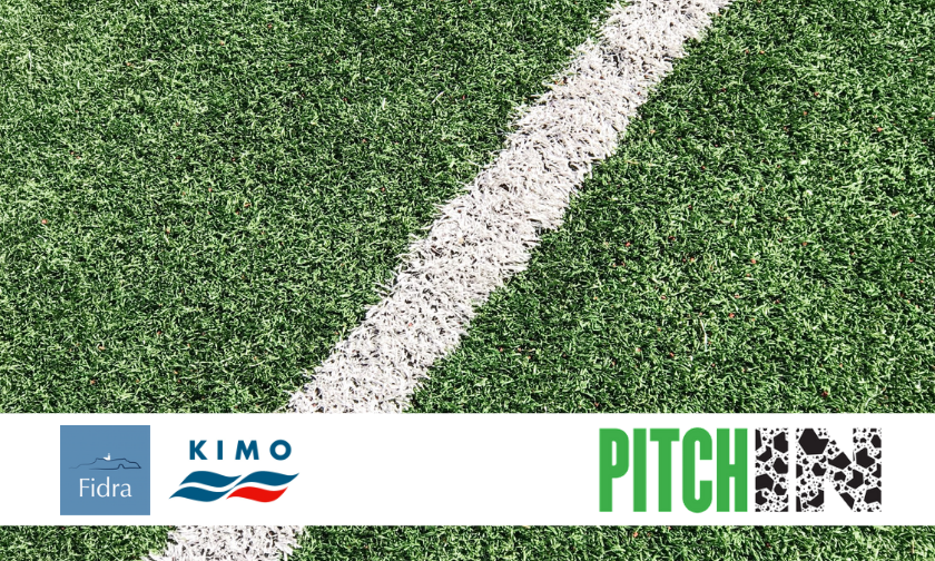 A white stripe on an artificial grass sports pitch with a banner showing the Fidra, KIMO and Pitch In logos.